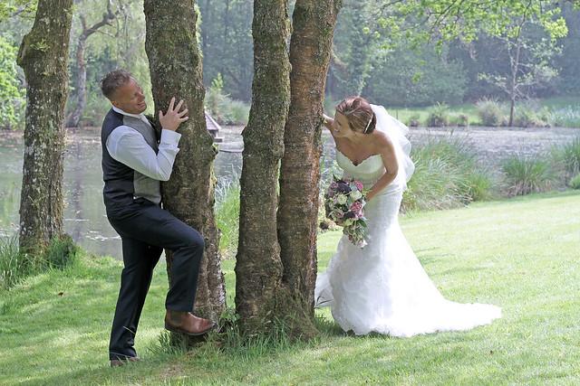 Bride & Groom playing beside the lake