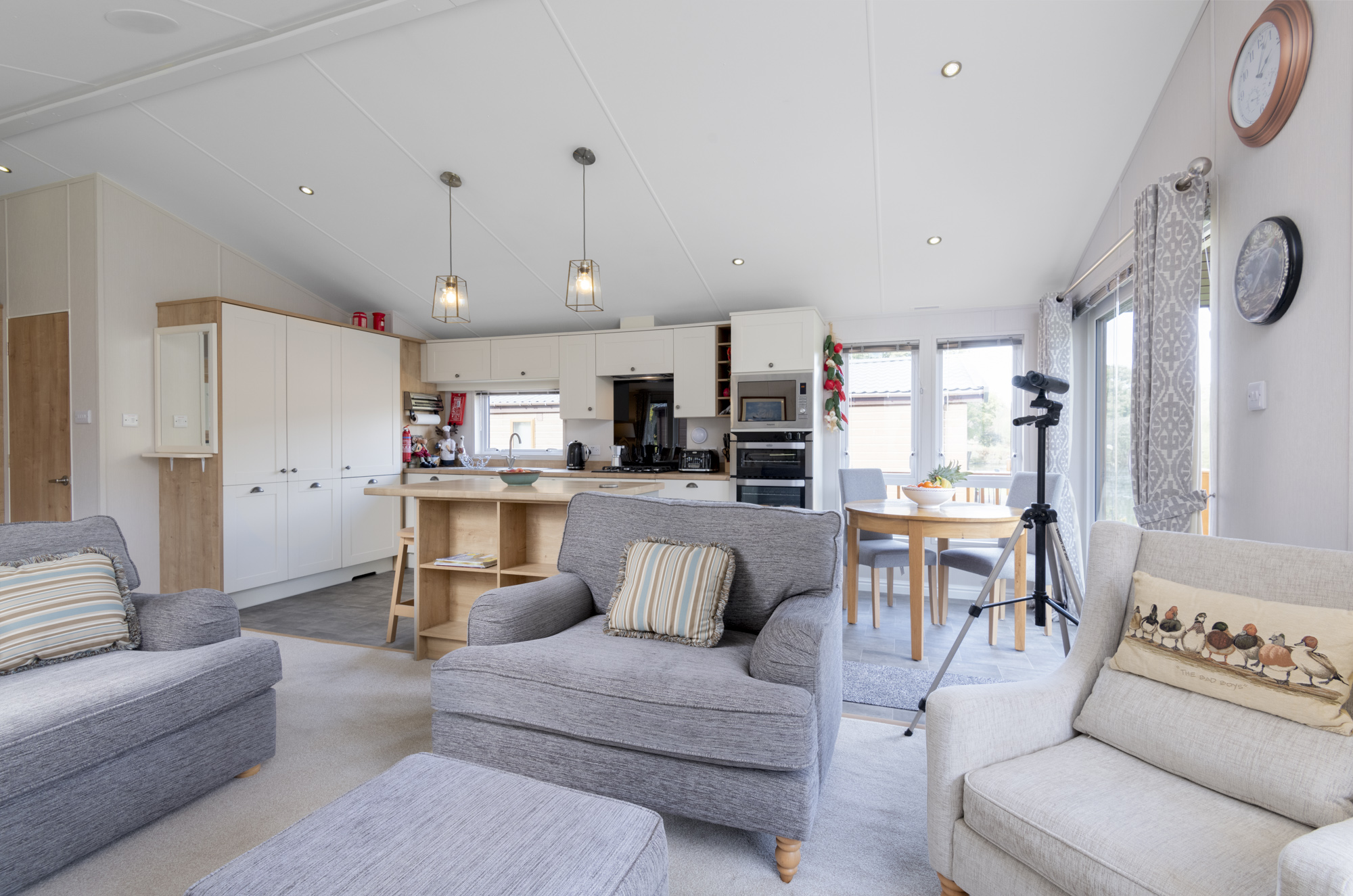 The open plan living room, kitchen and diner in Lakeside Haven