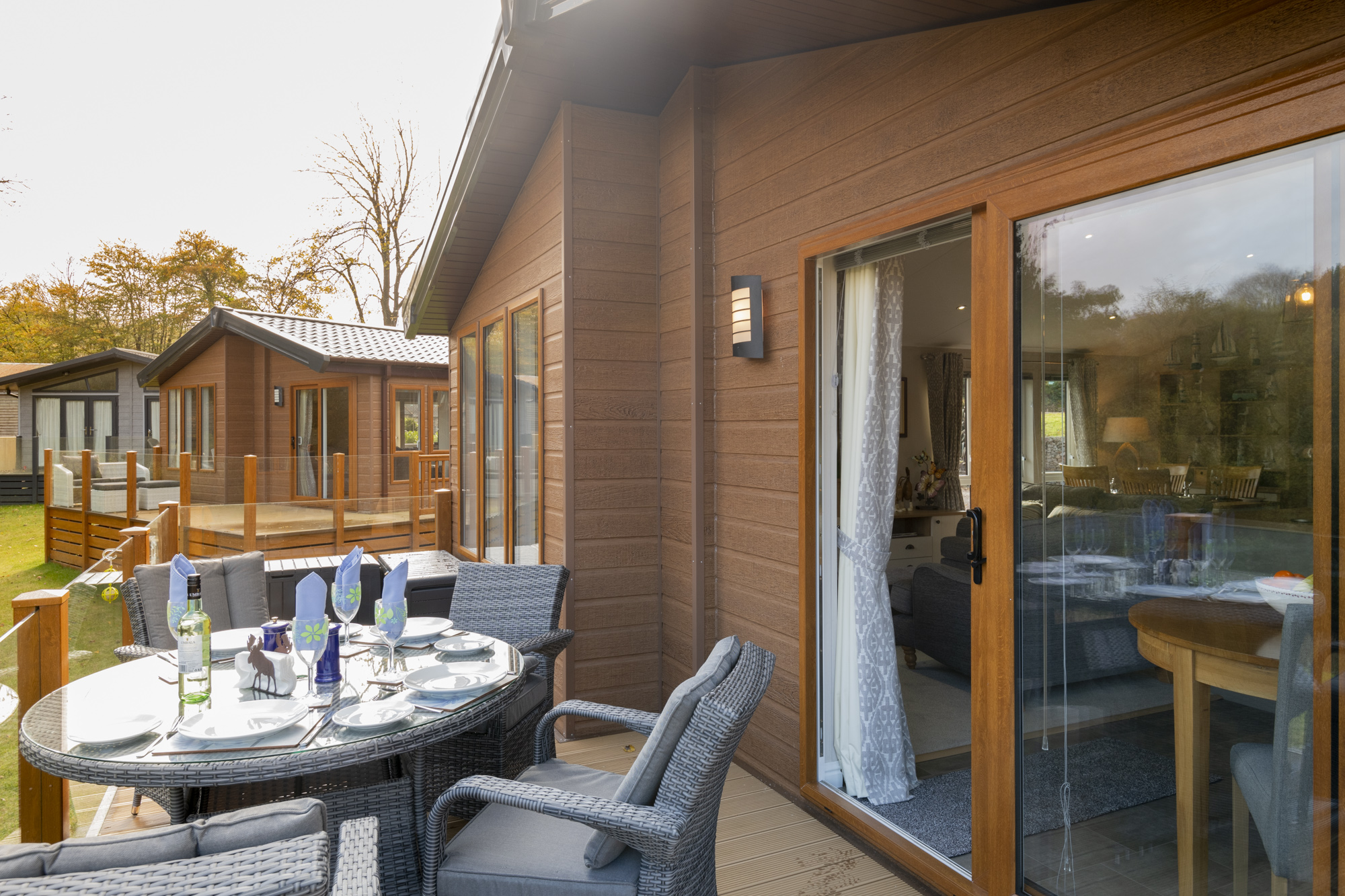 Glass of wine alfresco style at Lakeside Haven lodge